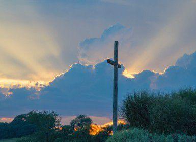 A wooden cross on a hill