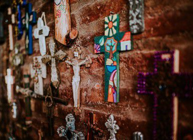 a selection of crosses on a wall